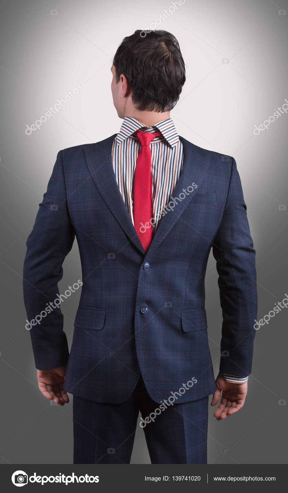 Man wearing his suit on backwards stock photo rodjulian 139741020 man wearing his suit on backwards stock photo ccuart Image collections