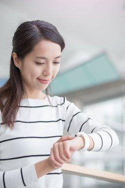 woman wear wearable smart watch