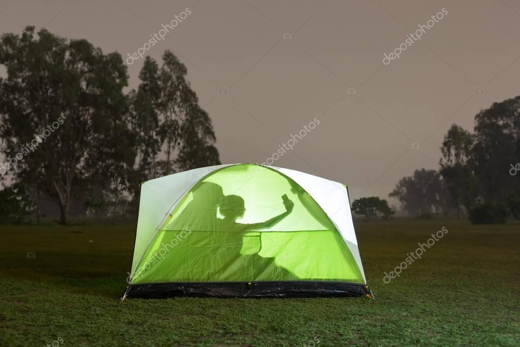 silhouette of couple camping