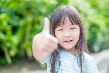 girl smile happily in park