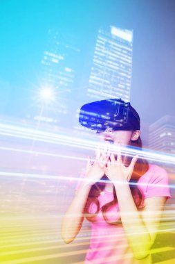 woman playing with  VR-headset