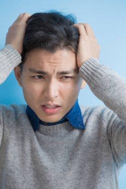 man feels headache