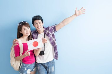 couple with flag of  japan