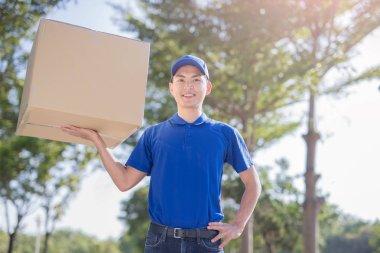 deliveryman holding  heavy box