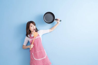 housewife holding  wok and rice spoon