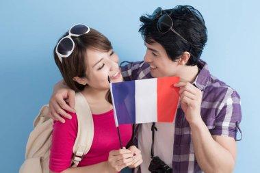 couple holding  french flag