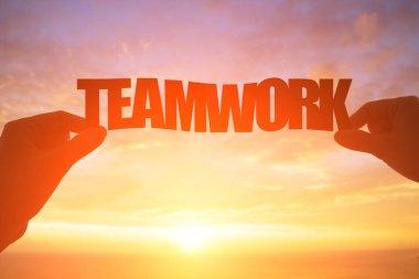silhouette of teamwork word