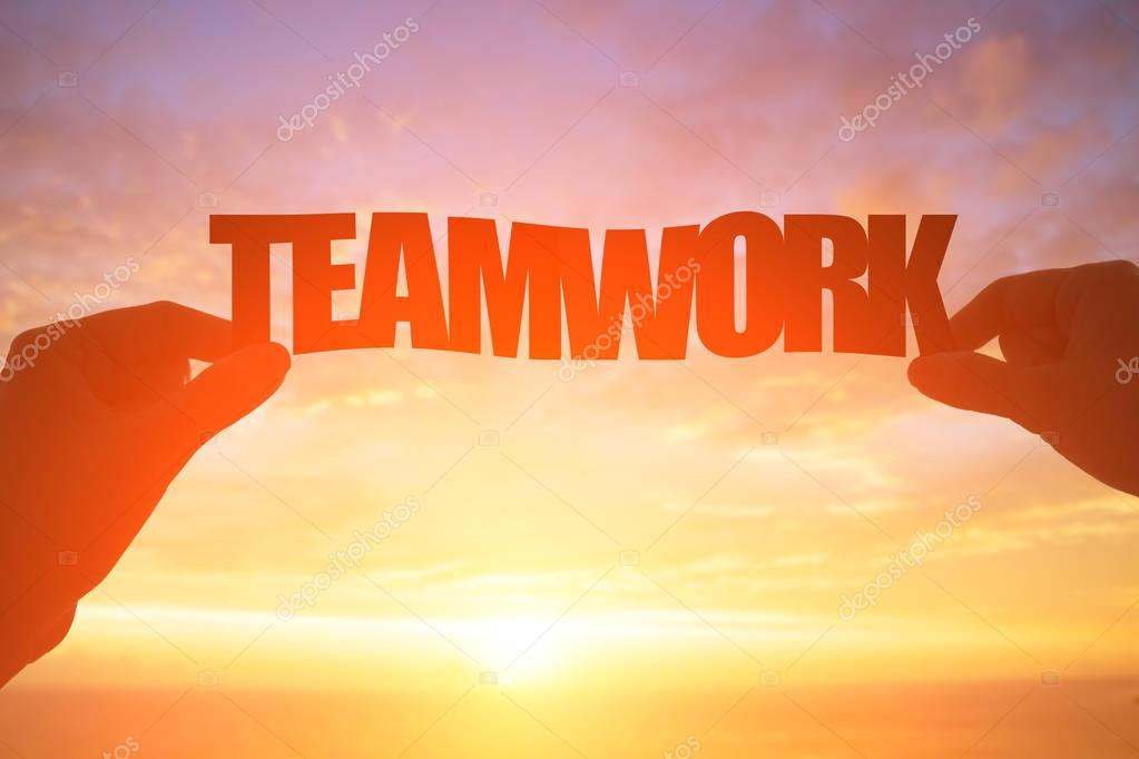 silhouette of teamwork word