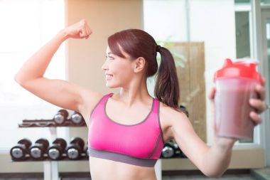 sport woman  holds protein