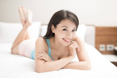 Beautiful  woman lying on bed