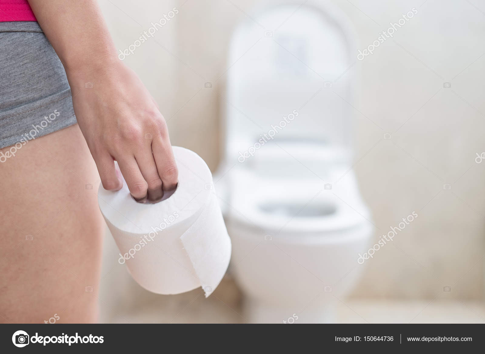 Woman Holding Toilet Paper Stock Photo