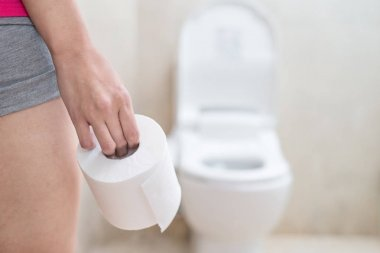 woman holding  toilet paper