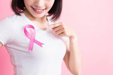 woman showing  pink ribbon