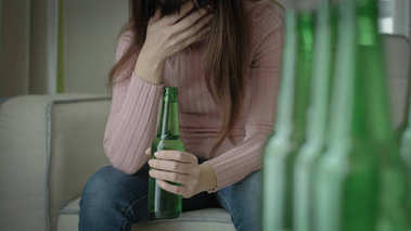 woman feeling  depression and alcoholism in the home