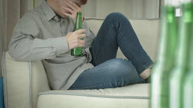 man feeling  depression and alcoholism at  home