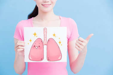 woman with healthy  lungs billboard and thumb up on the blue background