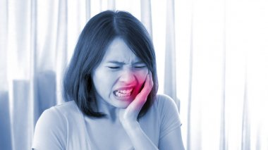 woman with  bad with toothache at  home