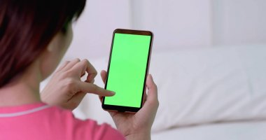 woman using  cell phone with green screen