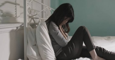 woman with depression in the room at home