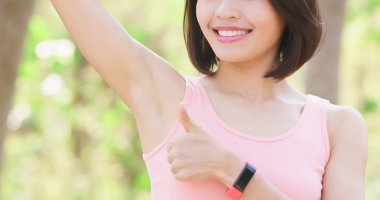 woman with underarm hair removal concept with green background