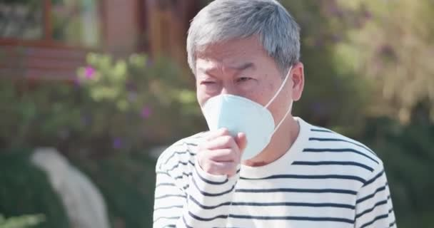 elder coughs and wears mask
