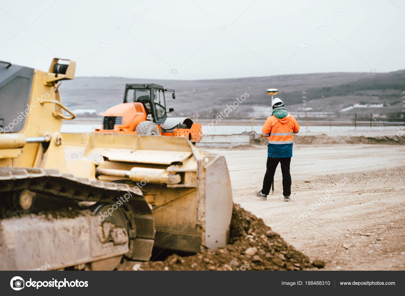 Surveyor engineer with GPS system outdoors at highway construction
