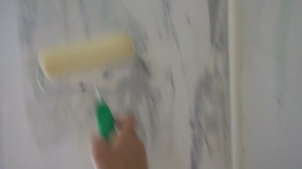 Applying Wallpaper paste to the wall
