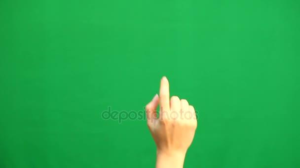 Gesti delle mani. Touchscreen. Mano femminile che mostra i gesti multitouch in schermo verde