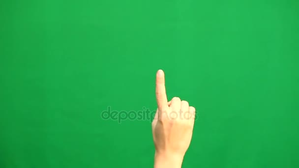 Kézmozdulatok. Érintőképernyő. Női kéz mutató multitouch gesztus zöld képernyő