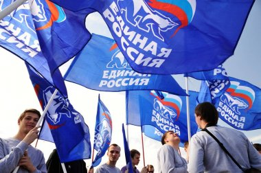 Orel, Russia - May 1, 2017: May demonstration. Young men with United Russia party flags