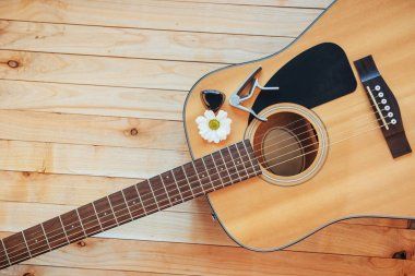 Photo fragment classical guitar on a light brown background
