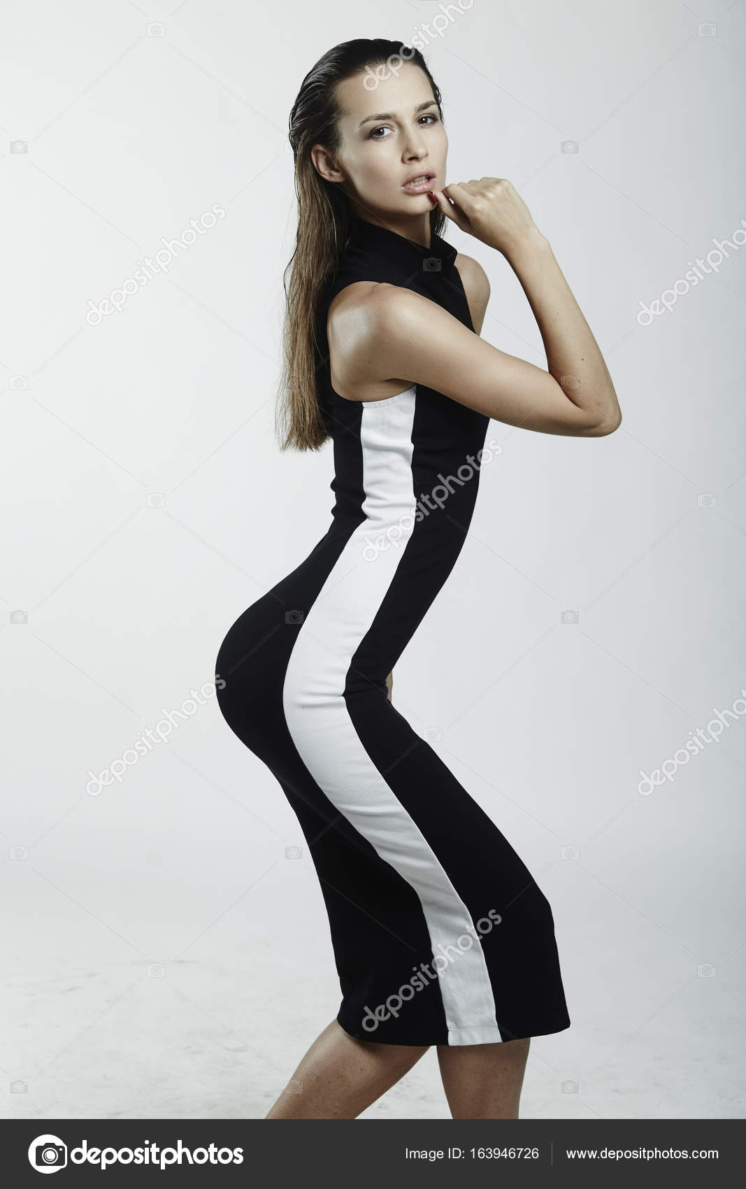 women in black and white dress with perfect ass shape. — stock photo