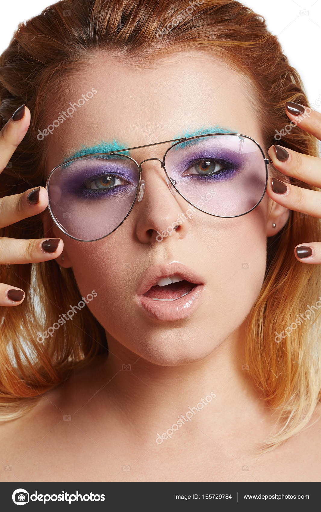 d0820367325 Beauty Fashion model girl wearing stylish glasses. Sexy woman portrait with  creative makeup and trendy fashion accessories. Beauty trends.