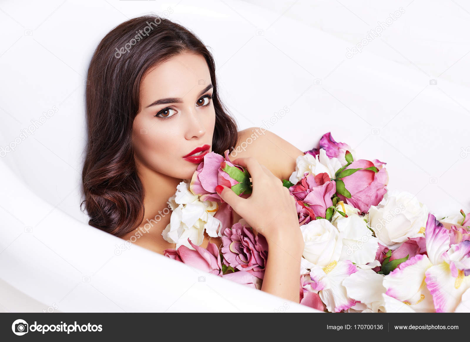 Fashion model girl taking flower bath, spa and skin care concept ...