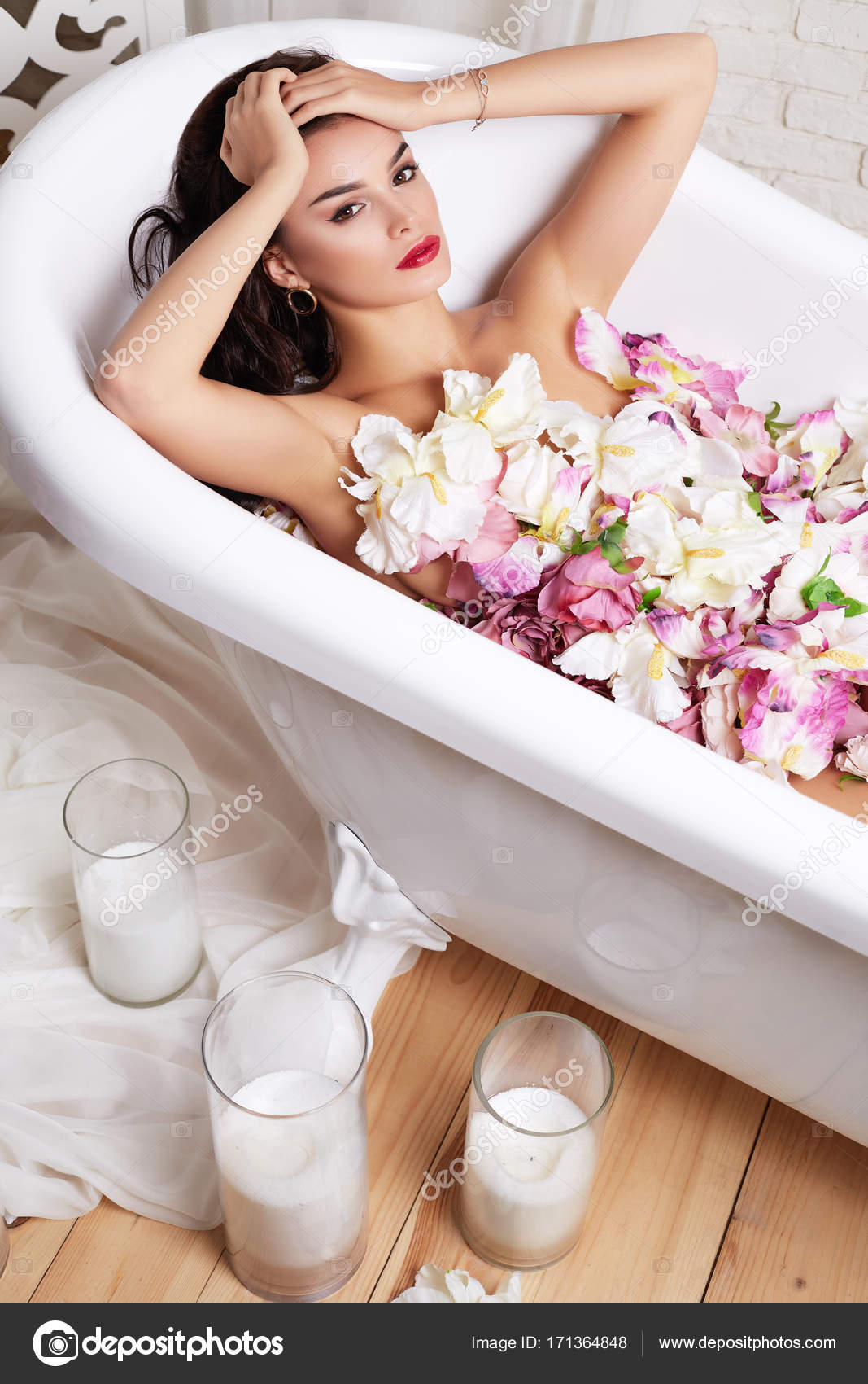 Spa beauty model girl taking flower bath, spa and skin care concept ...