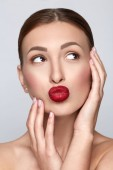 Beauty Woman Portrait with clean skin. Professional Makeup for Brunette. Beautiful Fashion Model Girl with red full lips. Perfect Skin Contouring Make up.