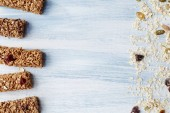 Granola bar. Healthy organic sweet dessert snack. Cereal granola bar with nuts, fruit and berries on a blue wooden table. Top view.