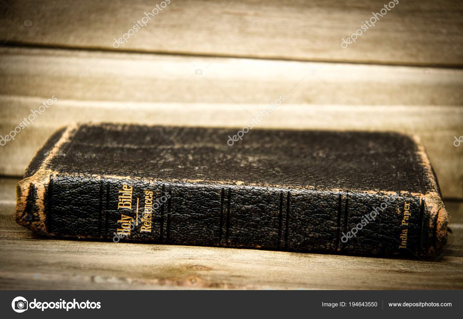 Bible Resting Its Side Wooden Table Only Spine Focus Slight