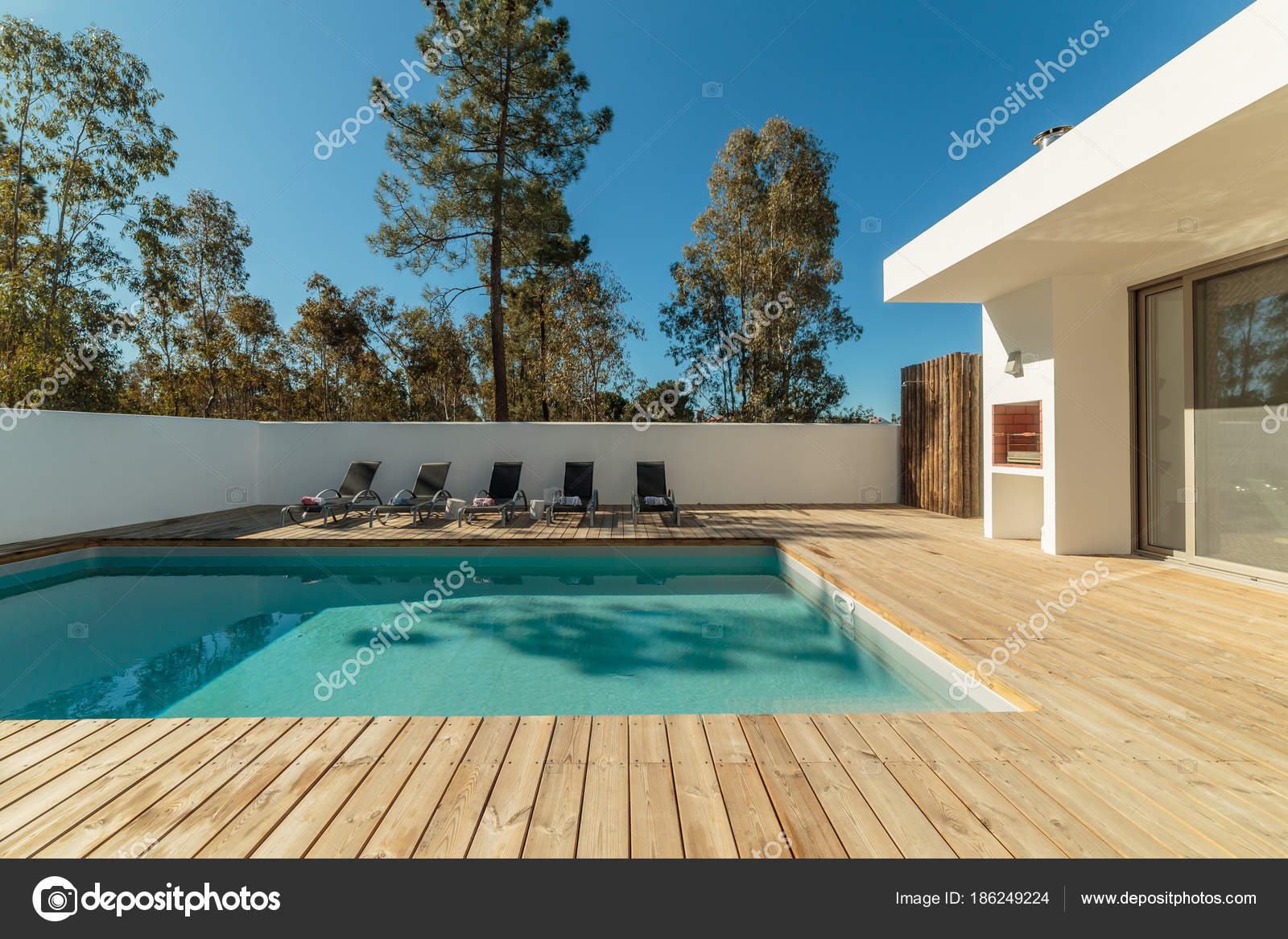 Modern House With Garden Swimming Pool And Wooden Deck Stock Photo Image By Papandreos 186249224