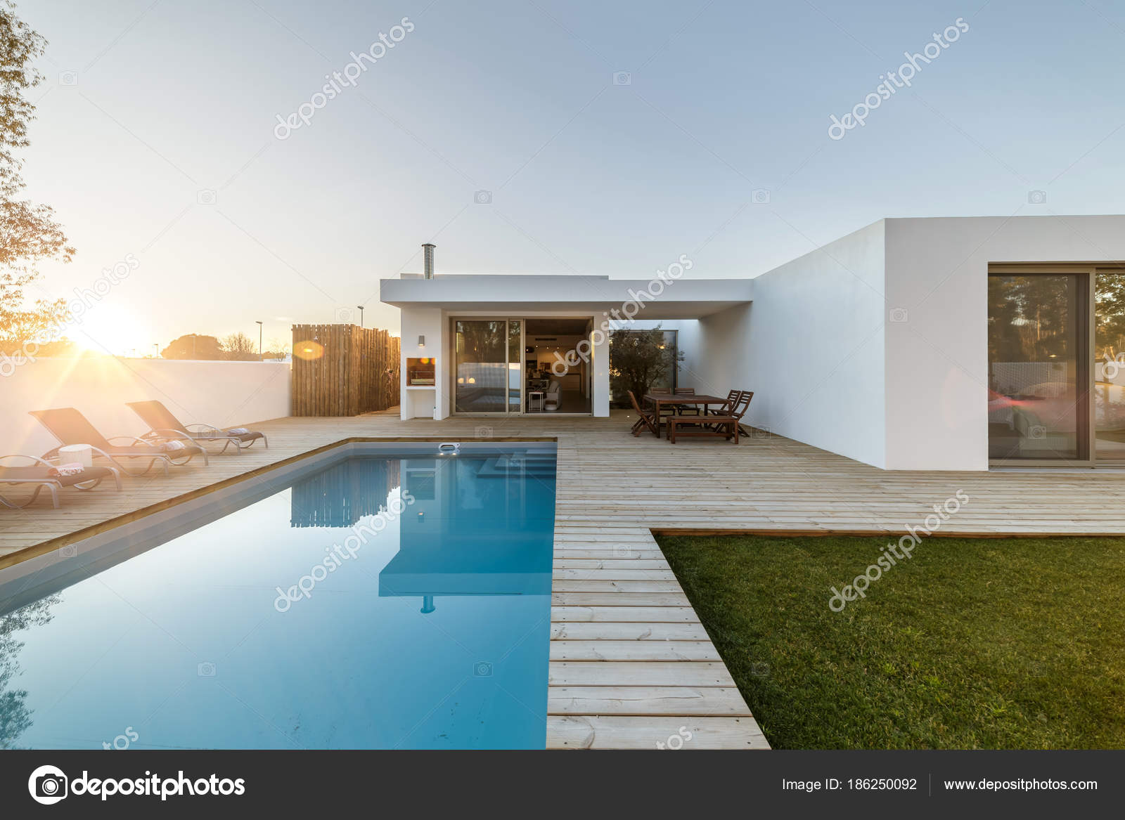 Modern House With Garden Swimming Pool And Wooden Deck Stock Photo Image By Papandreos 186250092