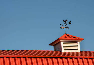Red Barn Roof with Rooster Weathervane