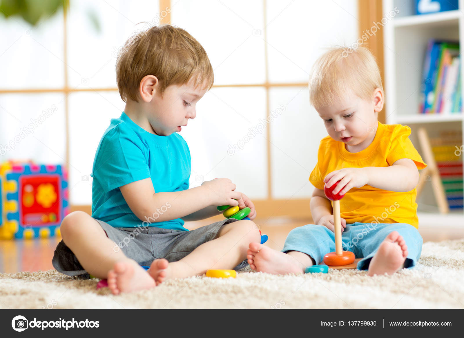 Children play with educational toys in preschool or ...