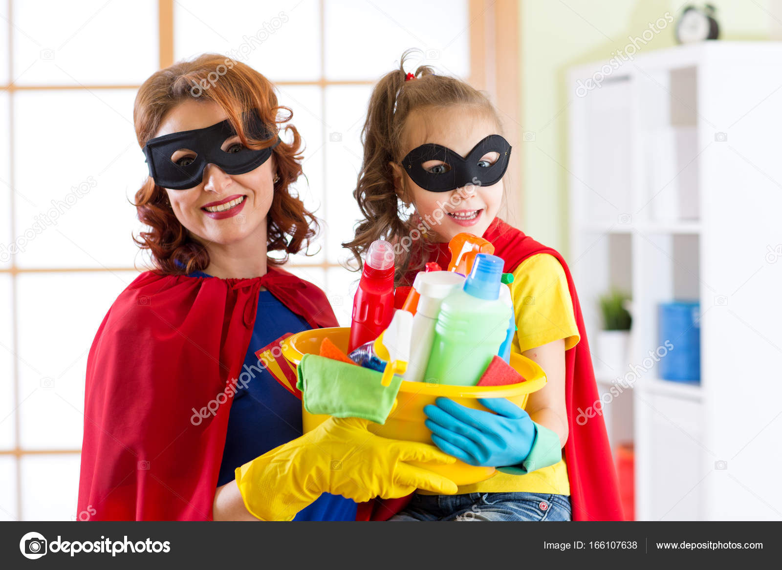 Delightful Woman And Her Child Daughter In Superhero Costumes. Mom And Kid Ready To  House Cleaning. Housework And Housekeeping. U2014 Photo By Oksun70