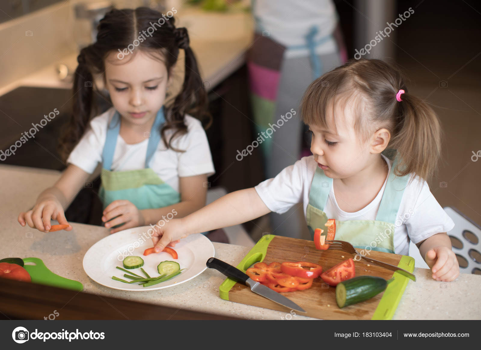 cute children helping mother at kitchen. adorable sisters making