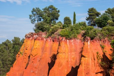 Reddish rock formations made of ocher near Roussillon village, Provence, France