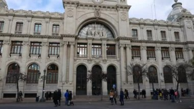 VALENCIA, SPAIN - MARCH 11, 2018: The Correos Building or Central Post Office in Valencia. Construction of the building began in 1915 and was finished seven years later. It was designed by the architect Miguel Angel Navarro.