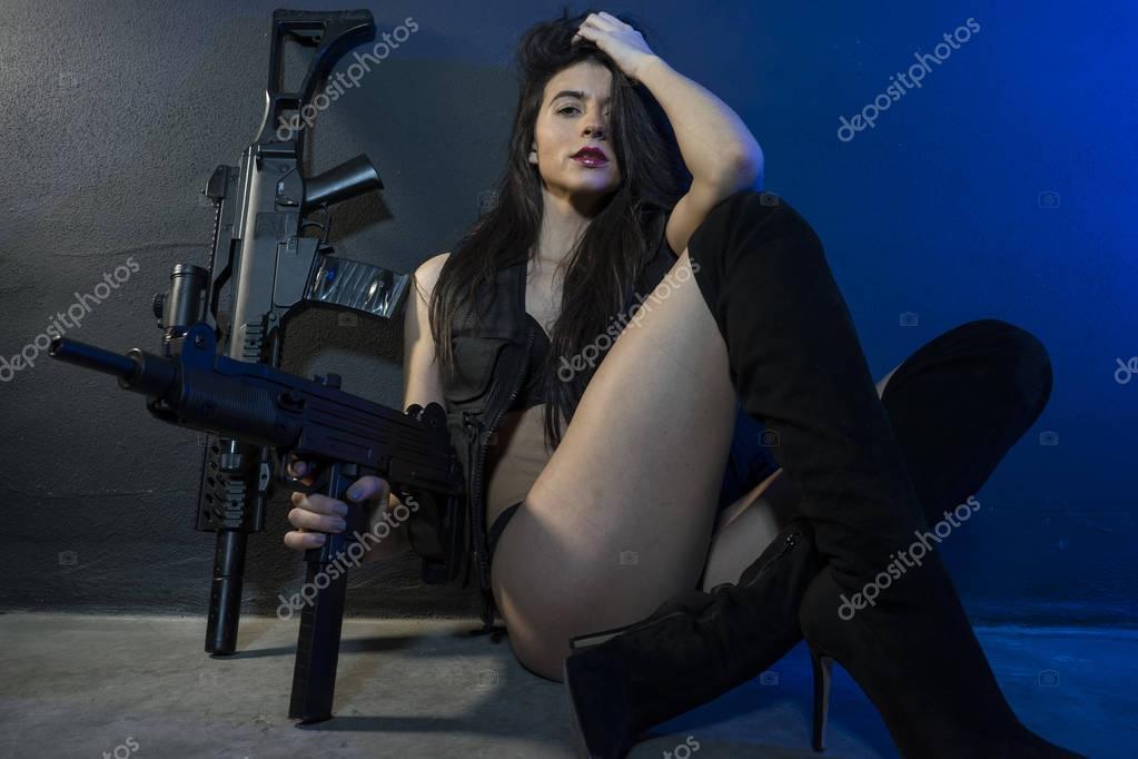 depositphotos_129529170-stock-photo-beautiful-girl-posing-with-guns.jpg