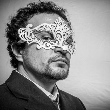 Sensual and mysterious businessman with venetian mask