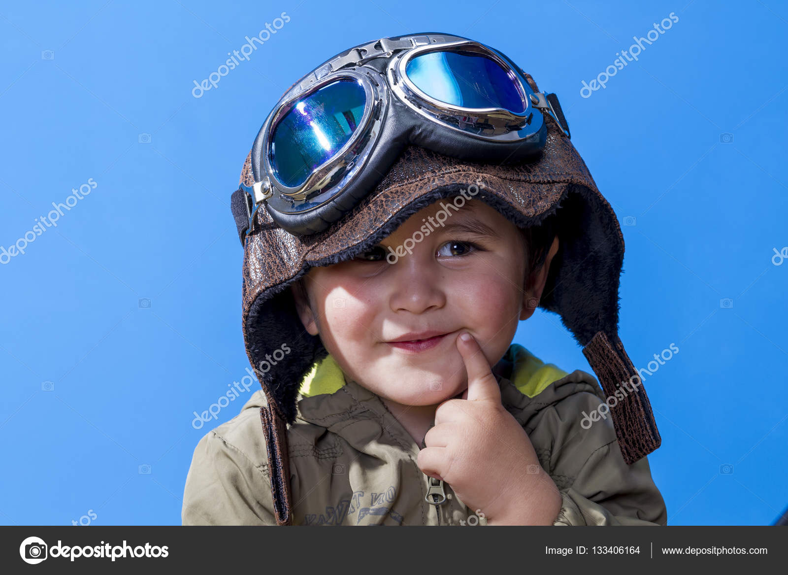 child dressed in aviator hat and goggles stock photo