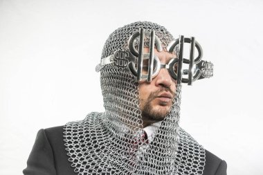 man with medieval chain mail and dollar-shaped glasses
